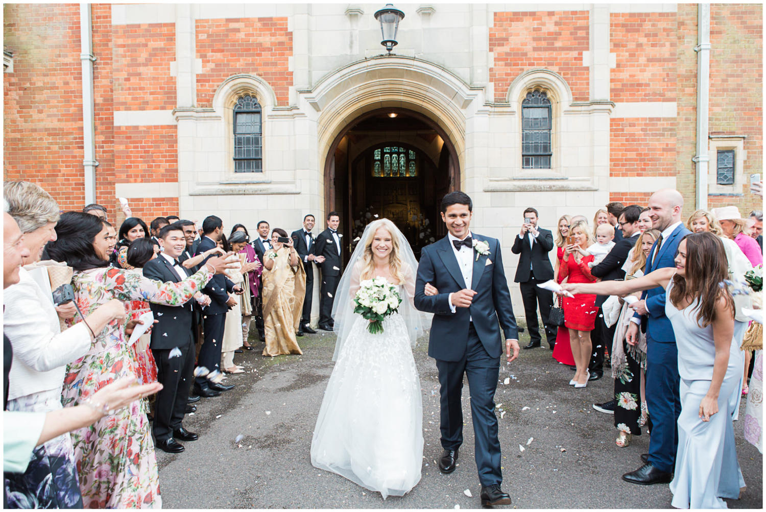 Bride and groom confetti shot, Classic wedding at Christ Hospital School with bride wearing Mira Zwillinger, Lucy Davenport Photography, Classic wedding