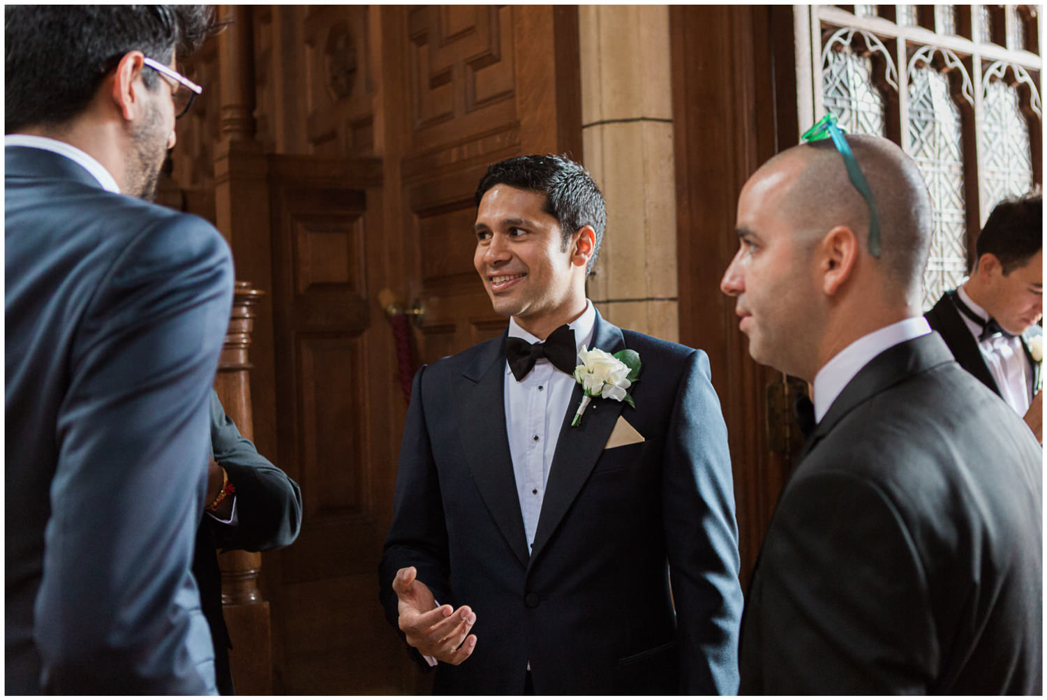 Groom greeting guests, Lucy Davenport Photography, Classic wedding