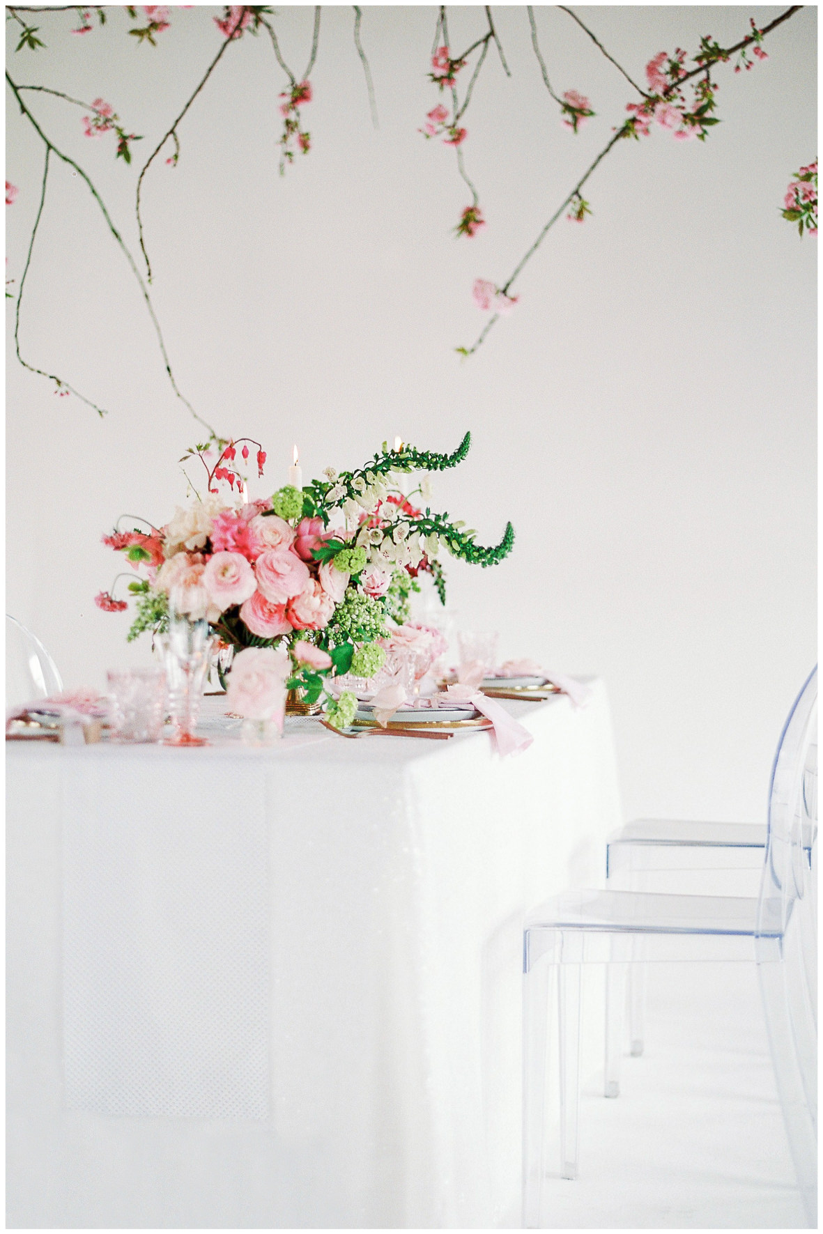 Lucy Davenport Photography, Loft Studios, Rebecca K Events, tablescape, soft pink, wedding breakfast, ghost chairs, suspended florals, florals, centrepiece
