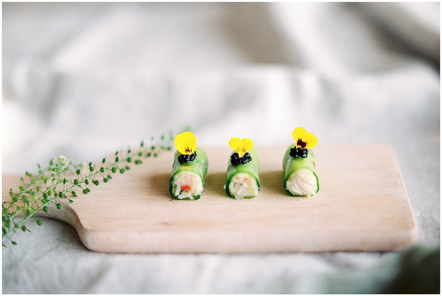 Canapés served on wooden block