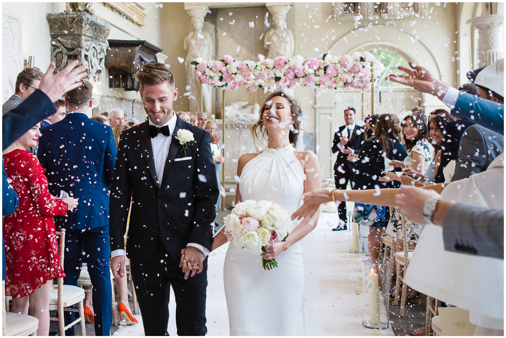 Lucy Davenport Photography, Aynhoe Park, Oxfordshire, wedding venue, Rock My Wedding, Orangery, bride and groom confetti