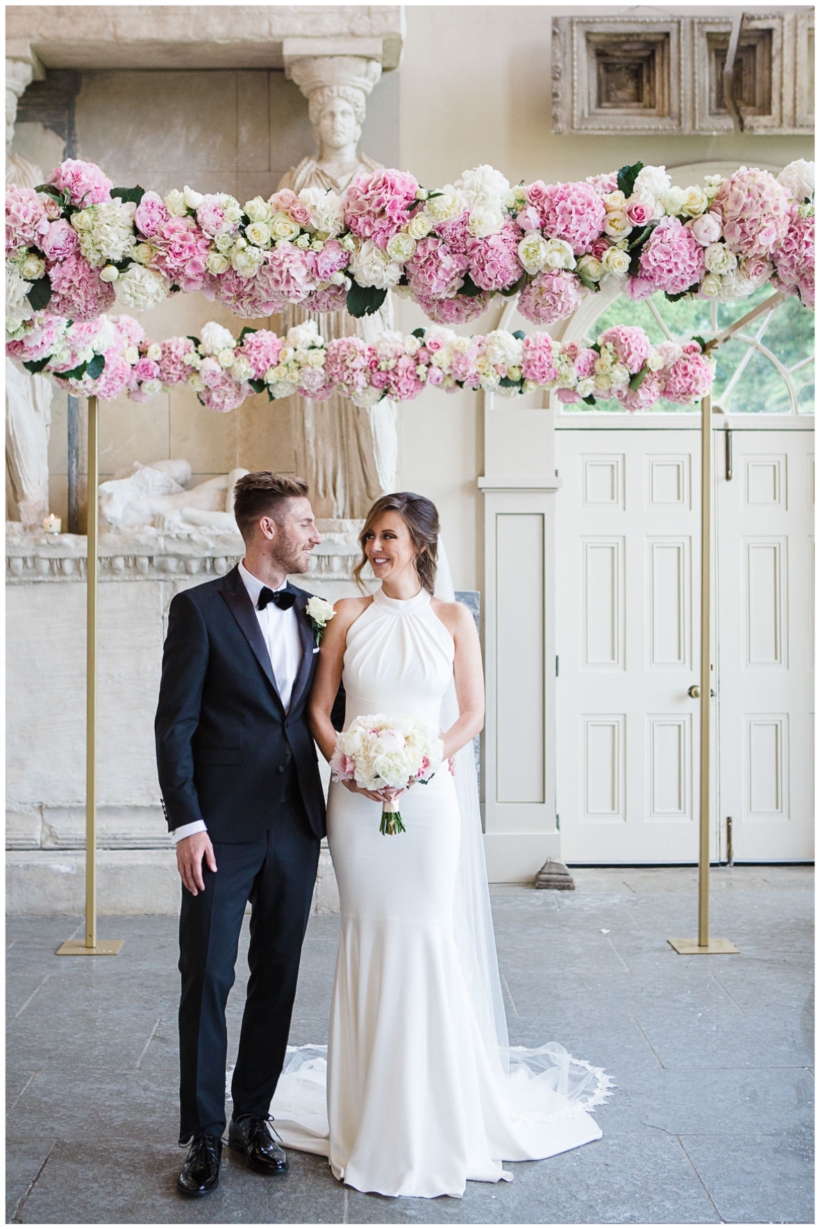Lucy Davenport Photography, Aynhoe Park, Oxfordshire, wedding venue, Rock My Wedding, Orangery, bride and groom floral chuppah