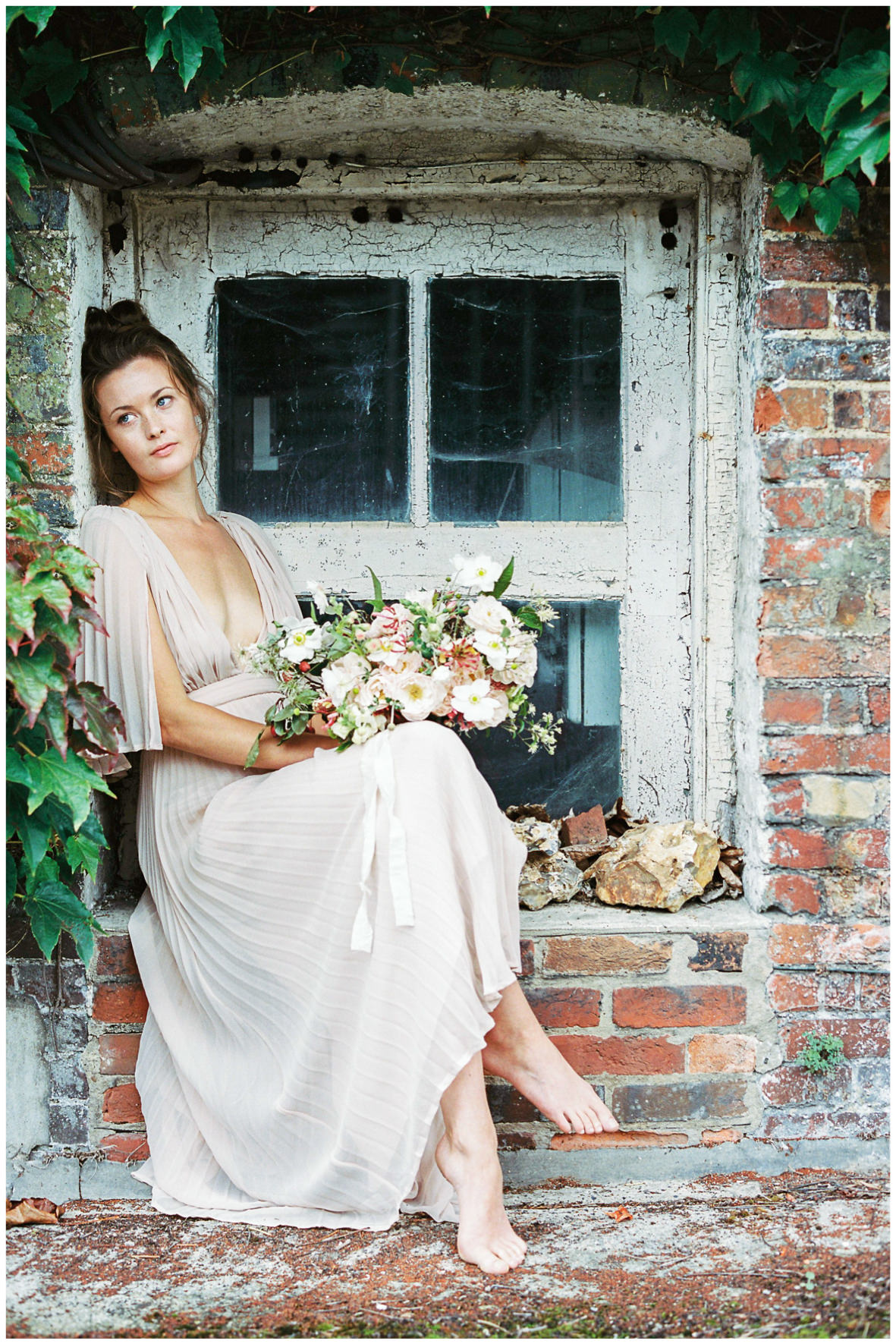 Lucy Davenport Photography, Once Wed, Home Creations, The Wedding Stylist, Verity & Thyme, model sat on window sill, florals, bouquet,
