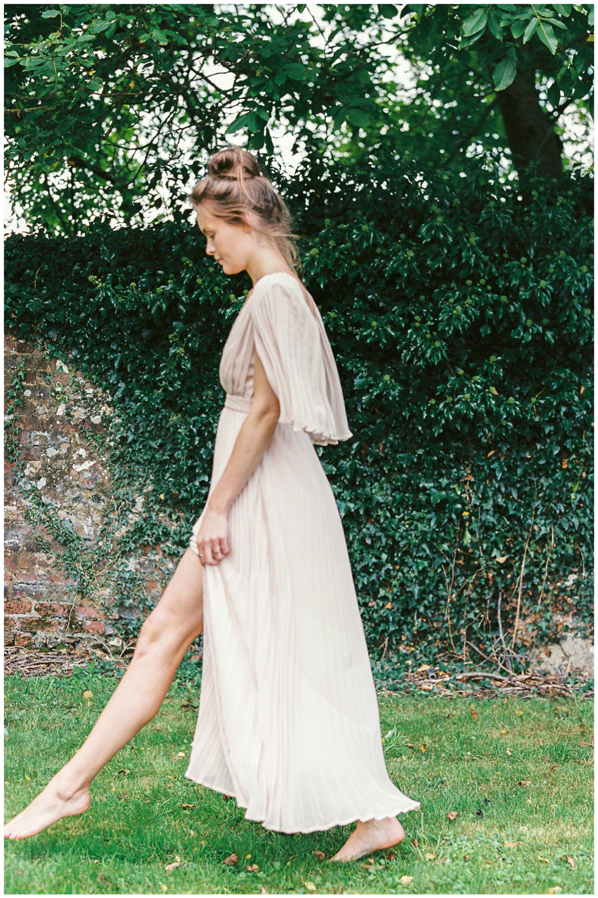 Lucy Davenport Photography, Once Wed, Home Creations, The Wedding Stylist, Verity & Thyme, model walking through grass, coloured dress