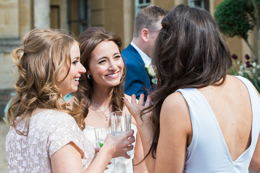 Bride laughing during drinks reception