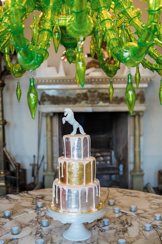 Gold and silver unicorn wedding cake