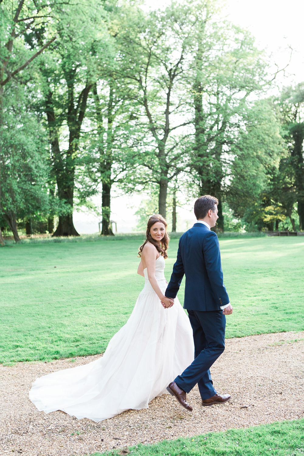Bride and groom strolling through gardens