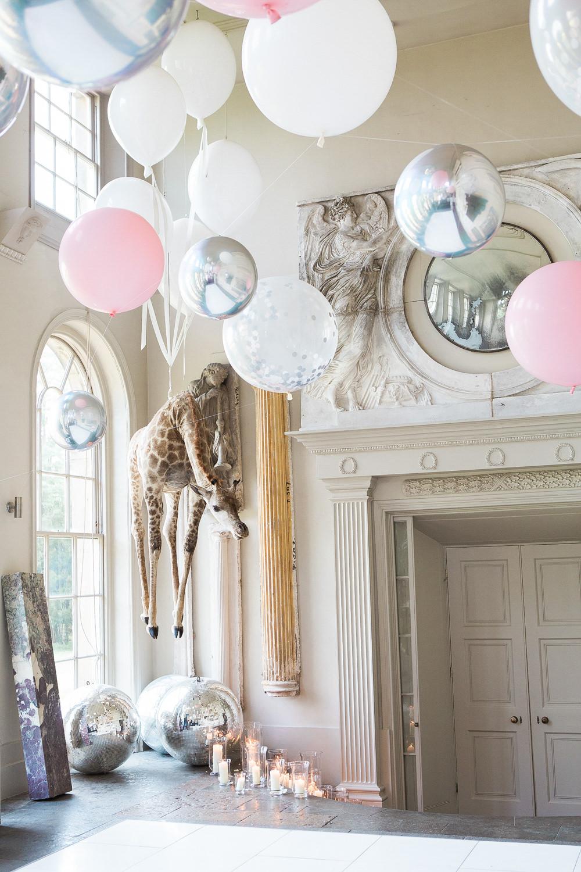 Balloons, giraffe and disco balls at Aynhoe Park