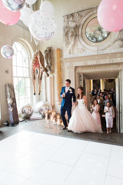 Bride and groom enter orangery