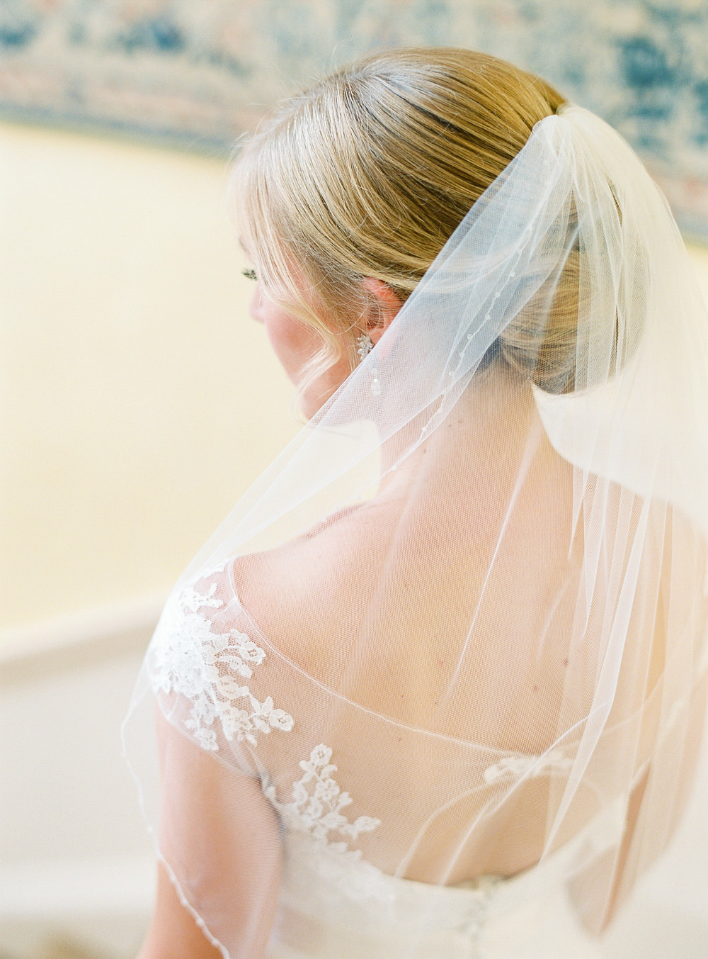 Bride looking out with veil