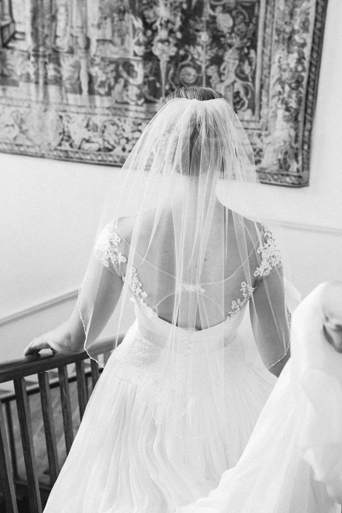 Black and white bride walking down stairs