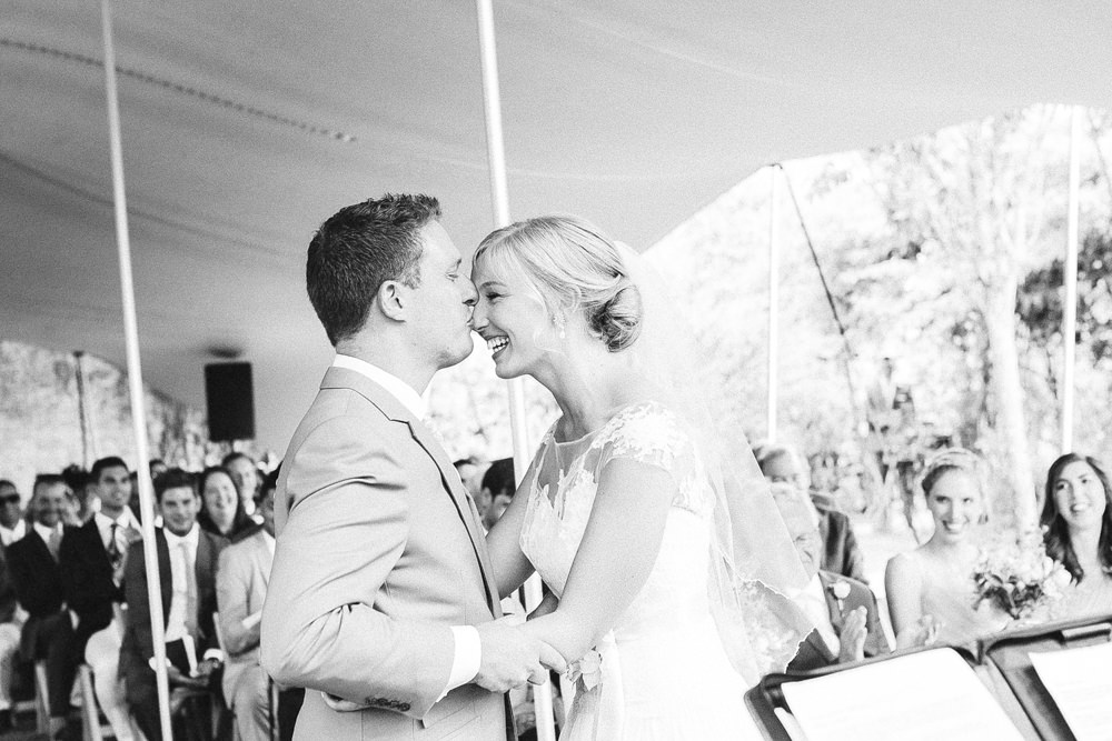 Groom kisses brides forehead