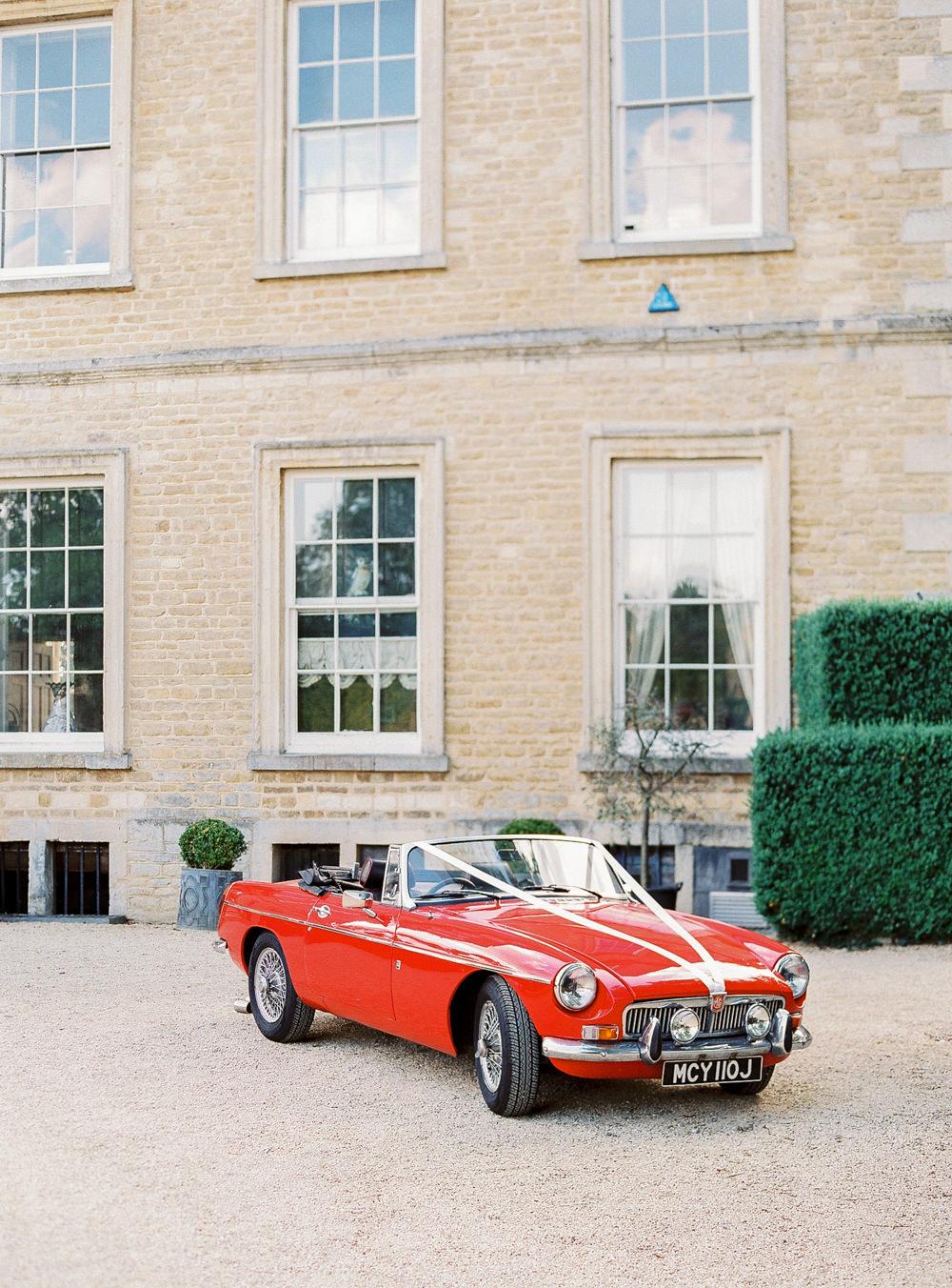 Red MG wedding car
