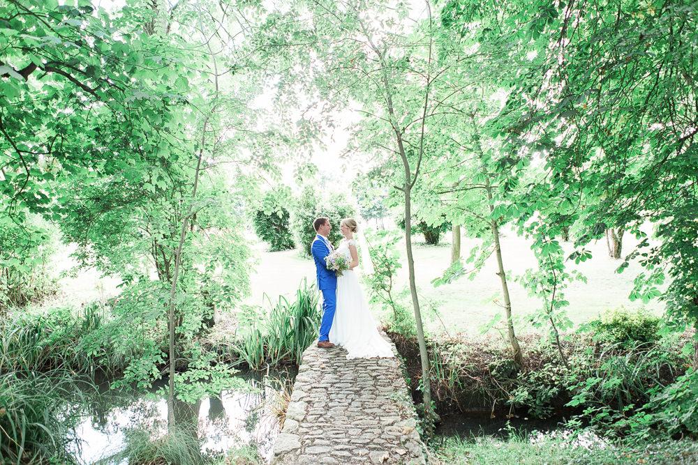 Bride and groom stood on bridge