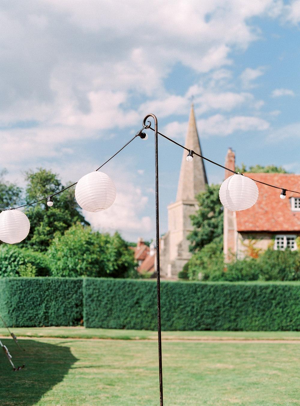 Paper lanterns hanging in garden