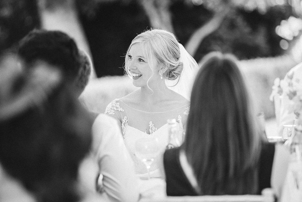 Bride during speeches, black and white