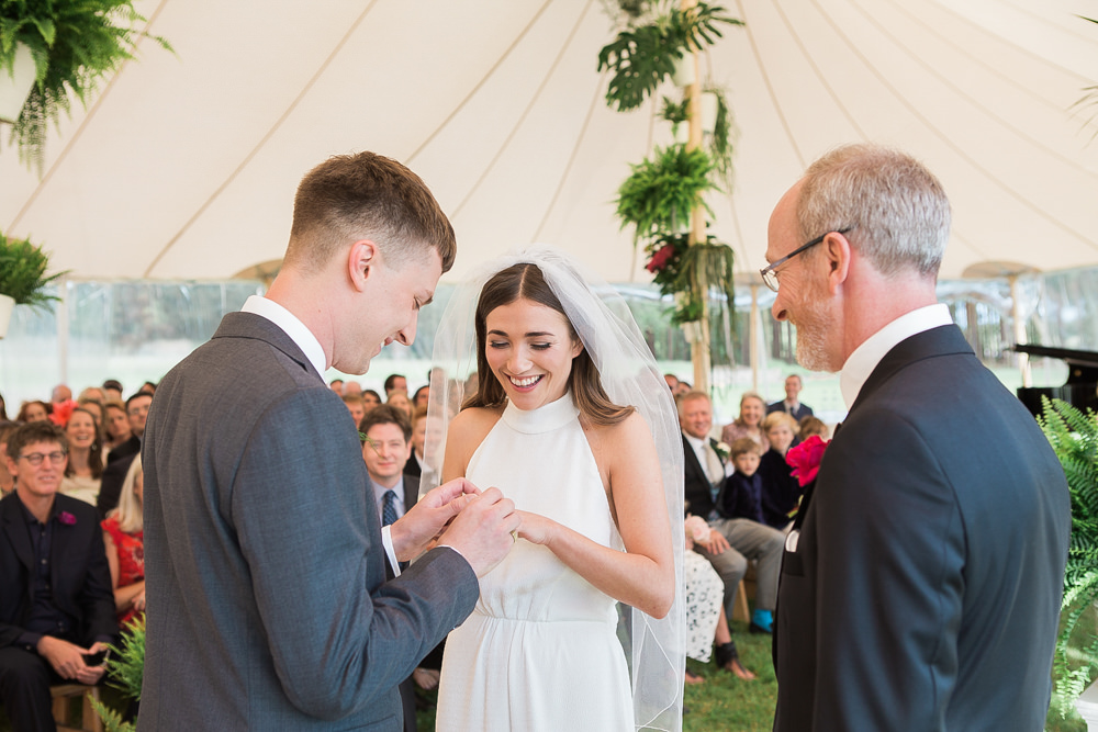 Bride and groom exchange rings