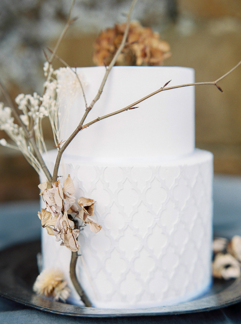 white geographic wedding cake