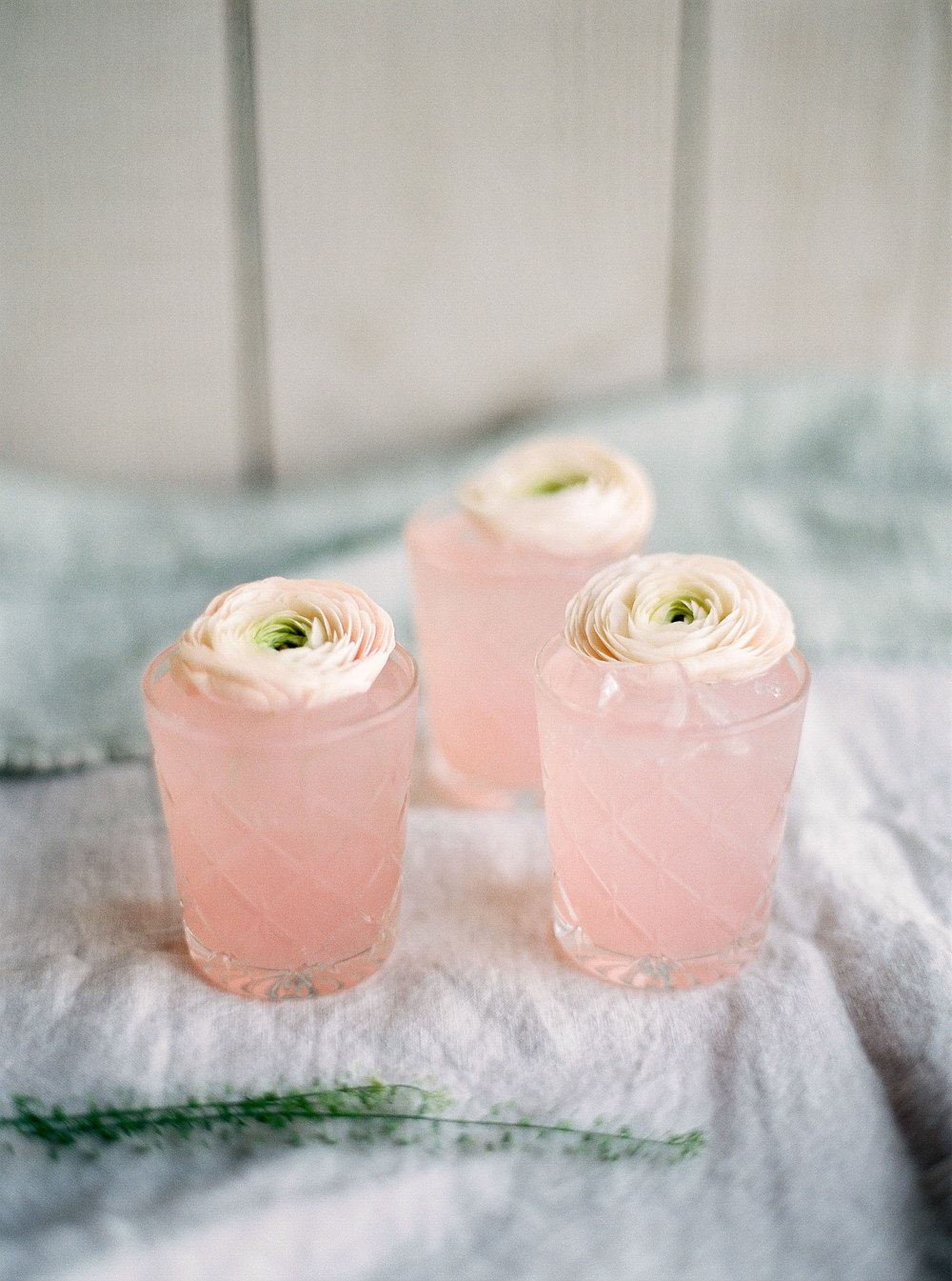 Blush pink soft drink with floral details