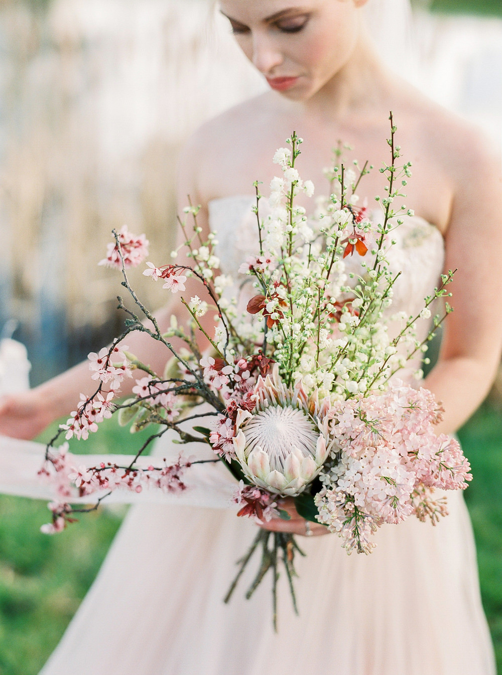 Statement bouquet and soft pink wedding dress