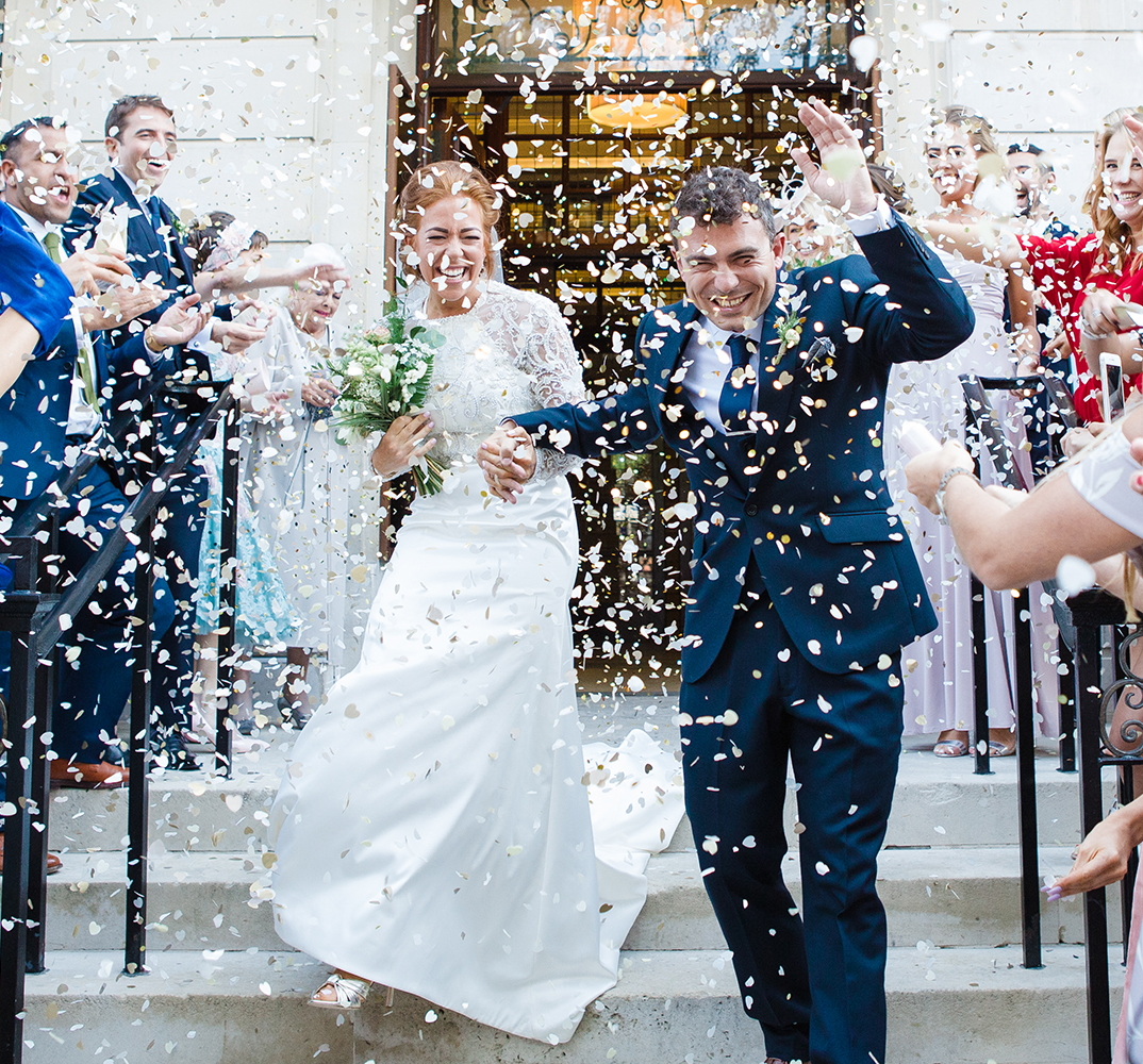 Bride and groom confetti thrown outside Town Hall Hotel