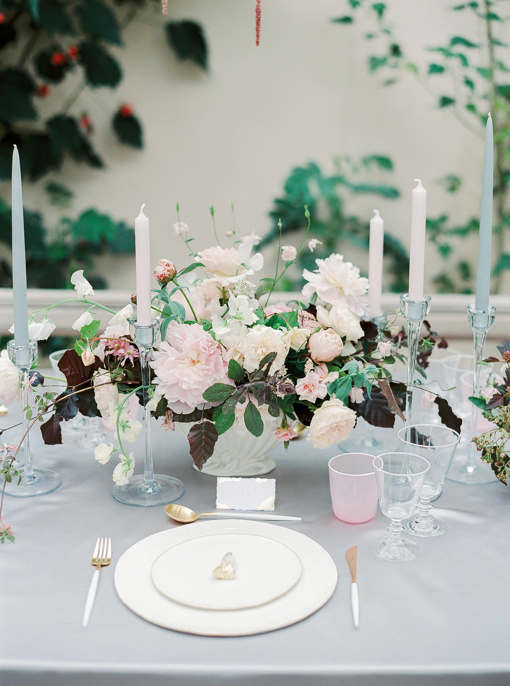 Place setting with floral centrepiece