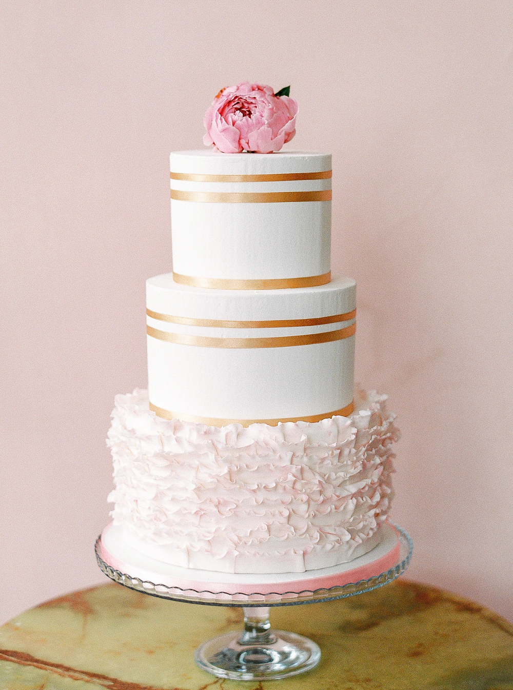 Three tier white and pink wedding cake