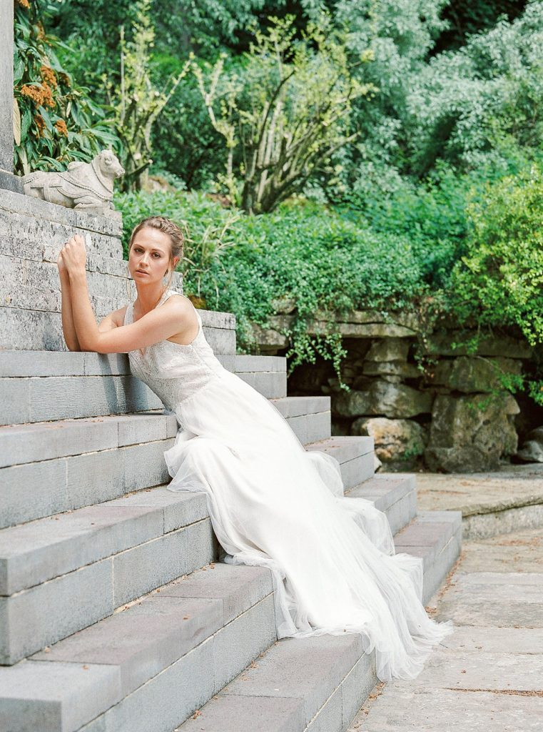 Bride laying on steps