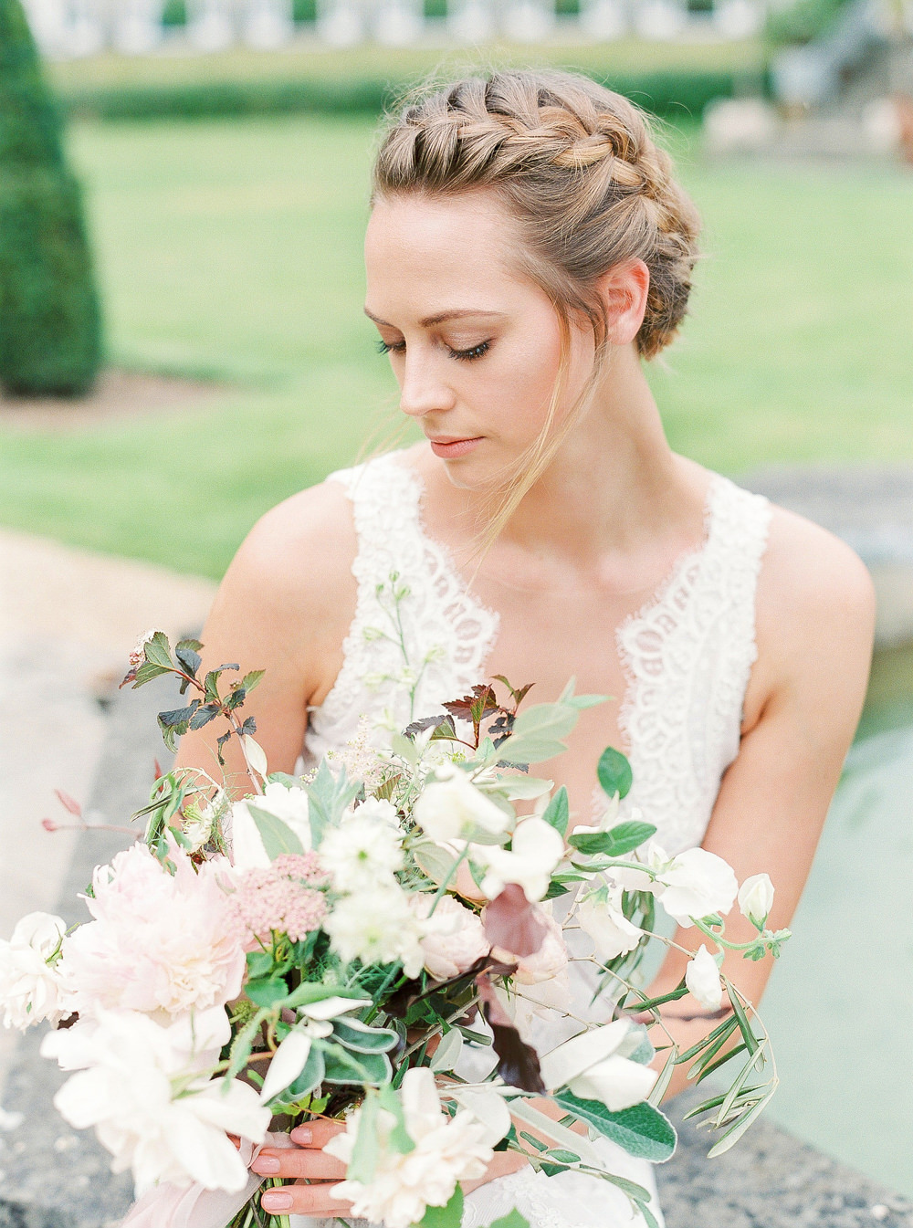 Bride with plaits and bouquet
