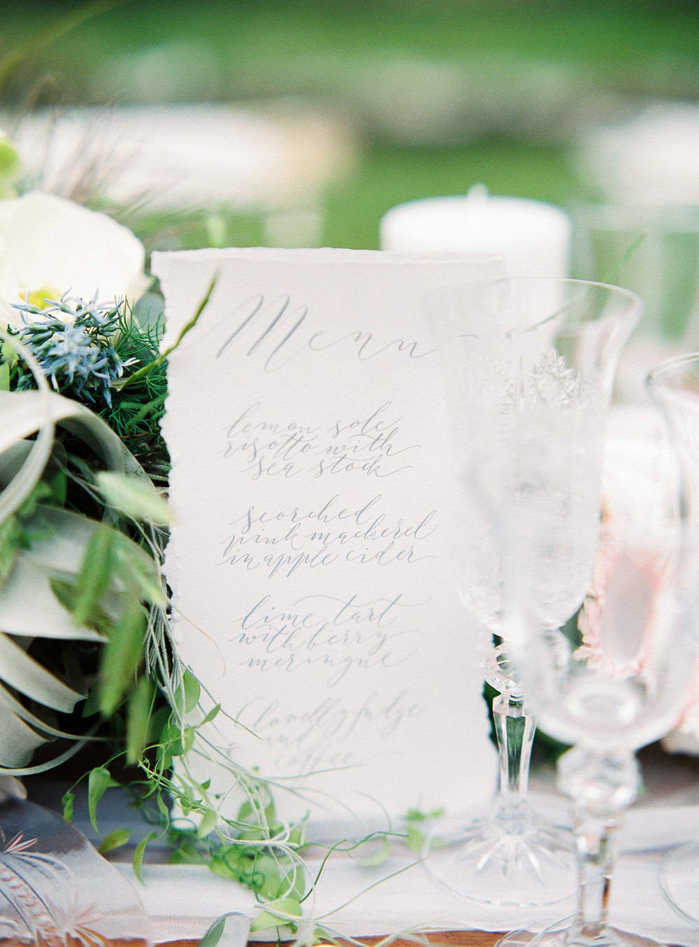 Calligraphy menu on tablescape