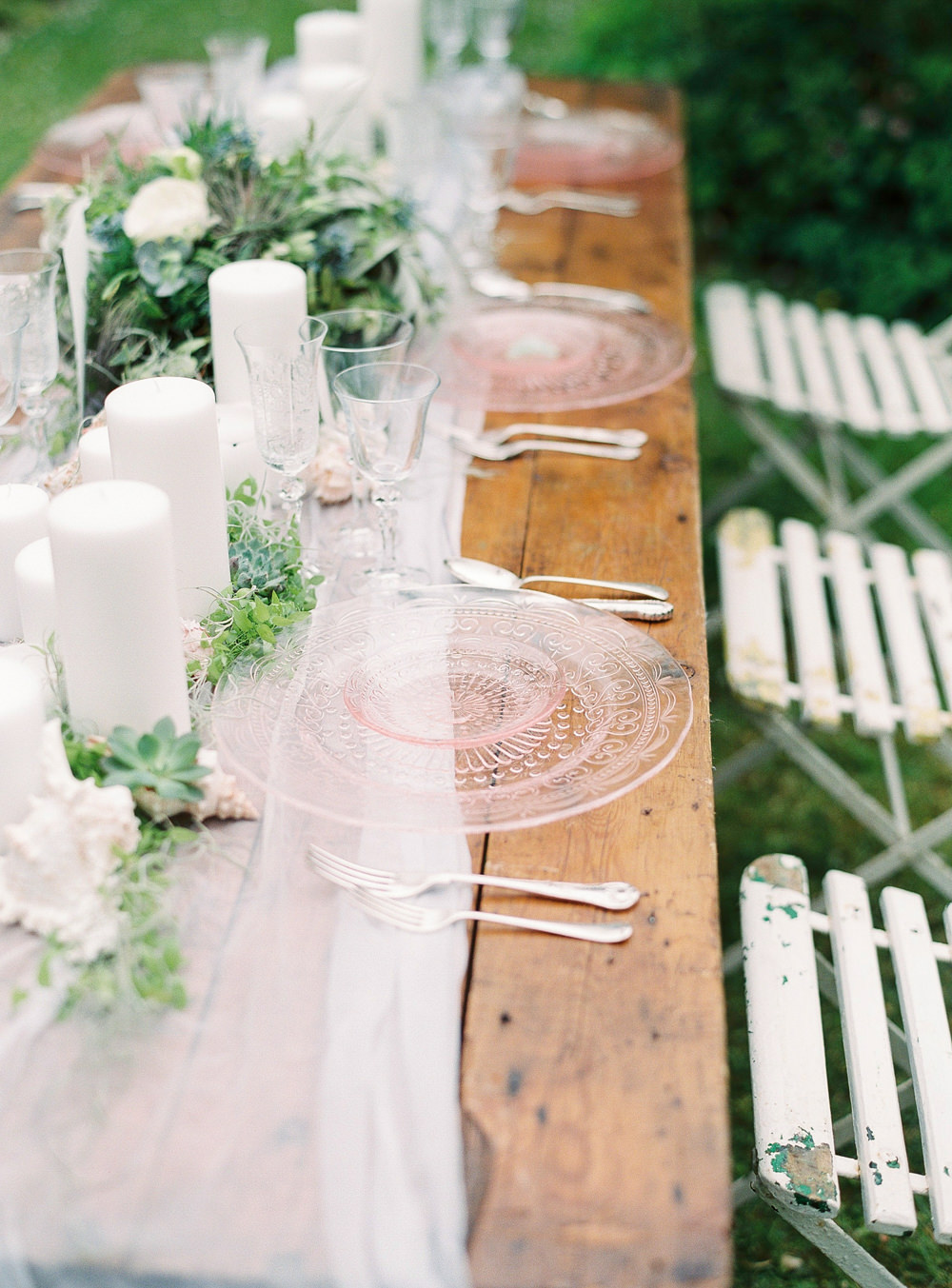 Tablescape with pink glass charger plates