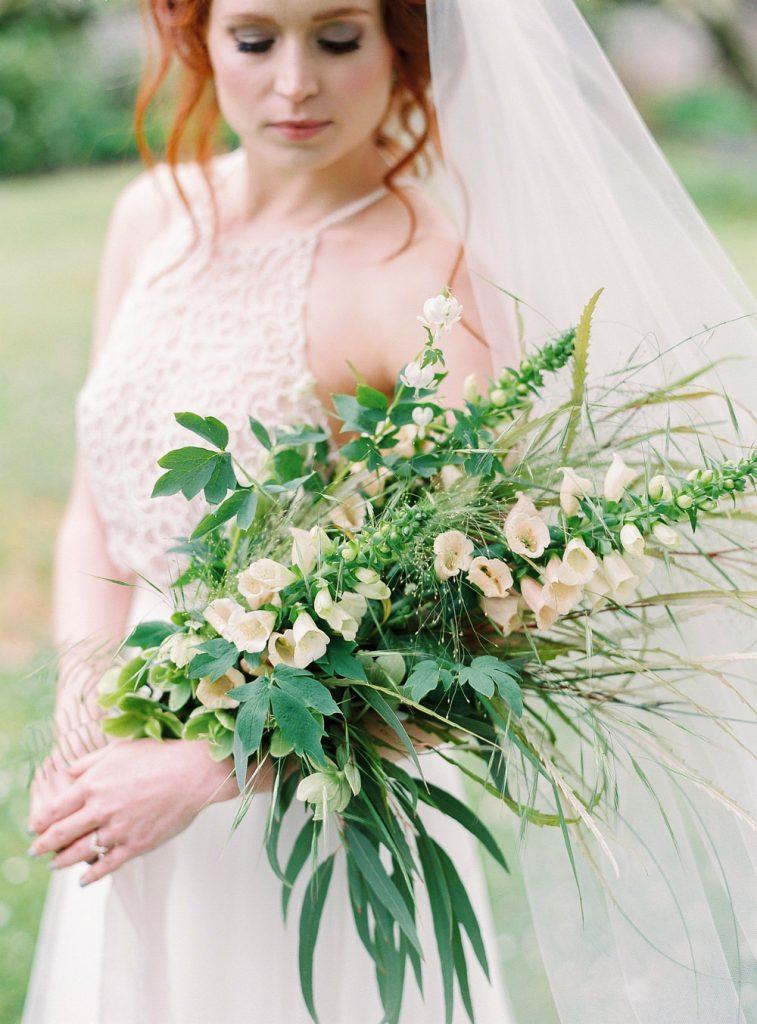 Halter neck wedding dress with bouquet