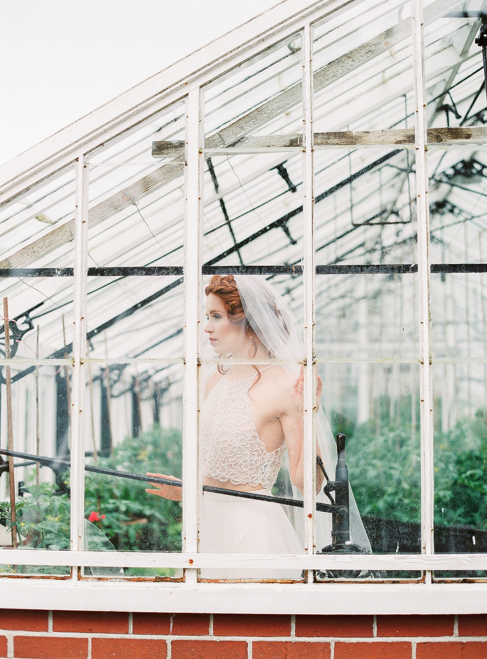 Bride in greenhouse with halter neck dress