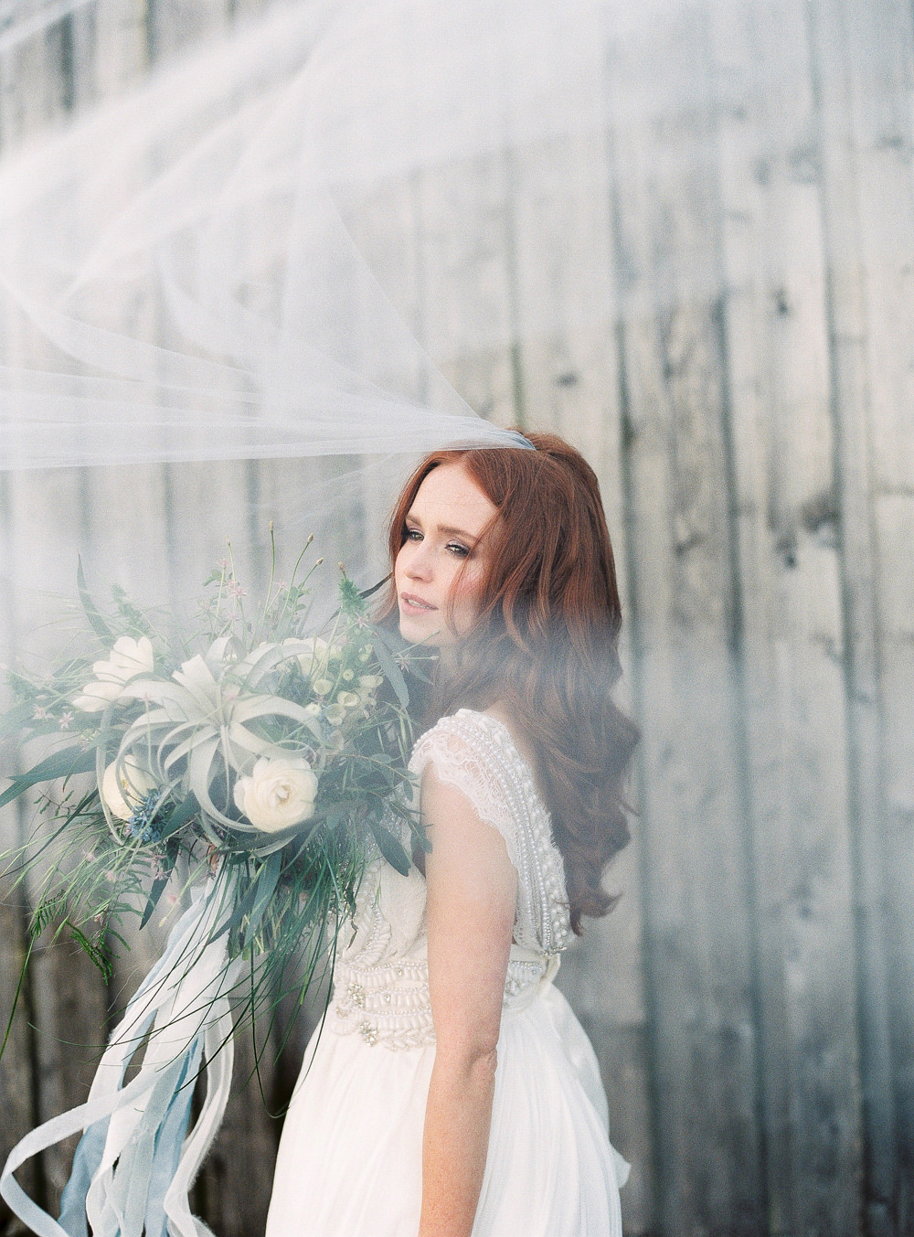 Windswept veil and bridal bouquet