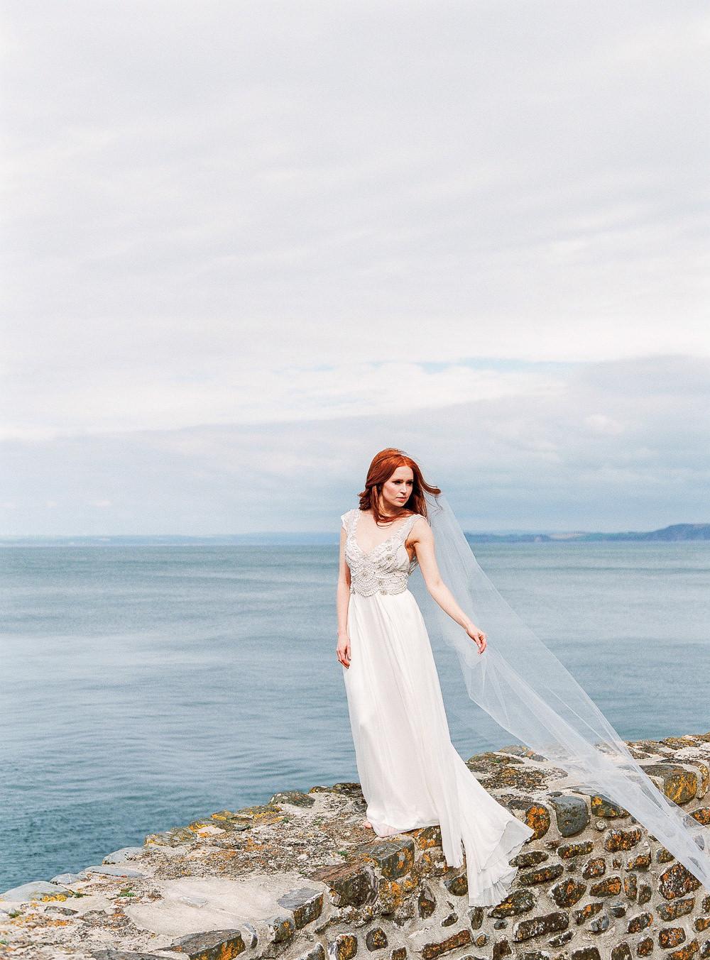 Bride standing on sea breaker, seascape