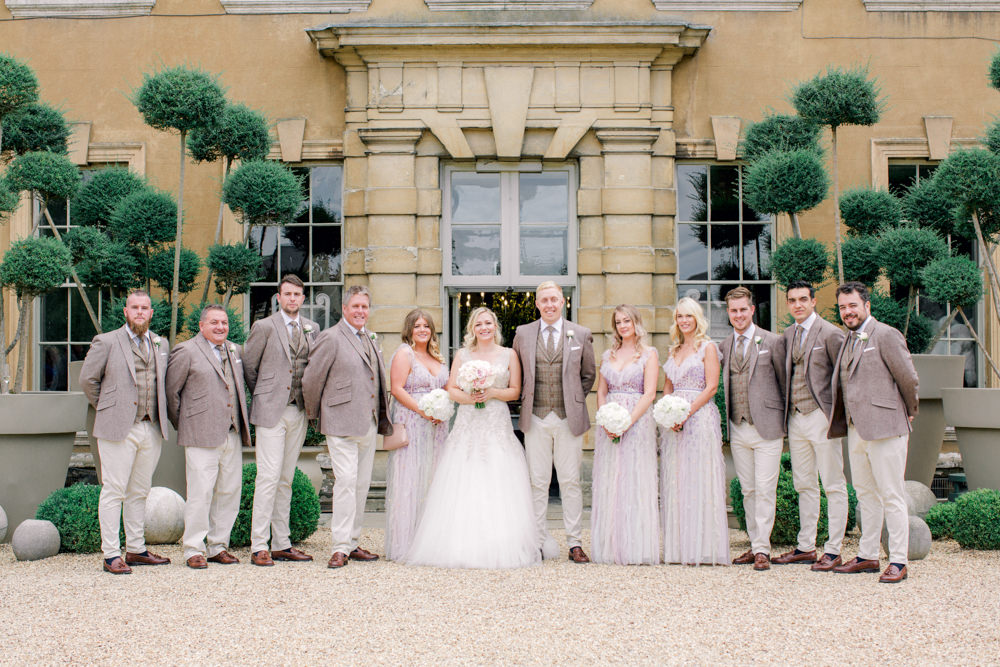 Bridal party formal photo outside Aynhoe Park