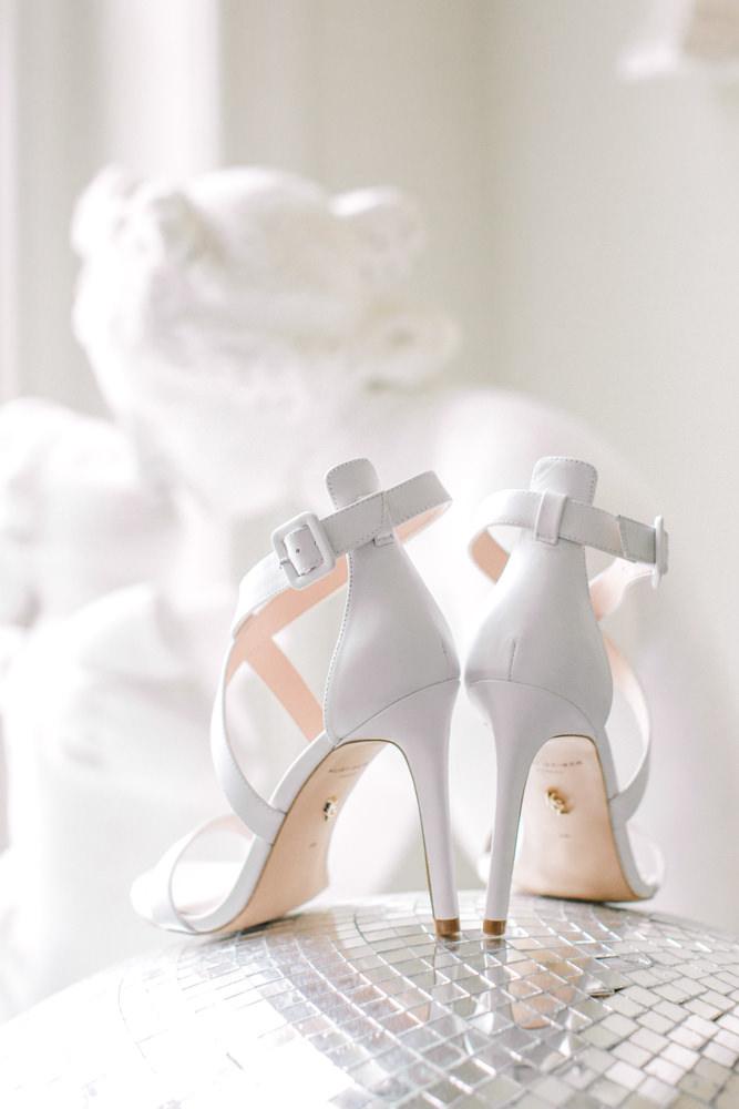 Brides wedding shoes on a disco ball