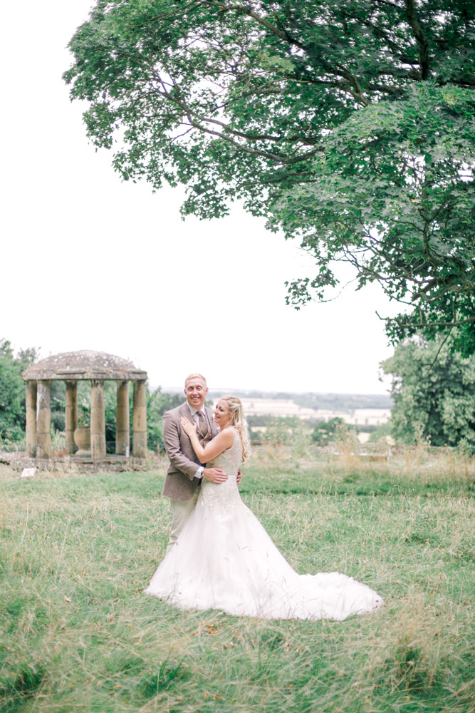 Bride and groom in the gardens of Aynhoe Park