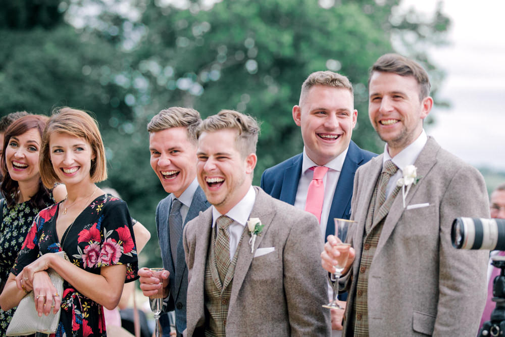 Wedding guest smiling during speeches