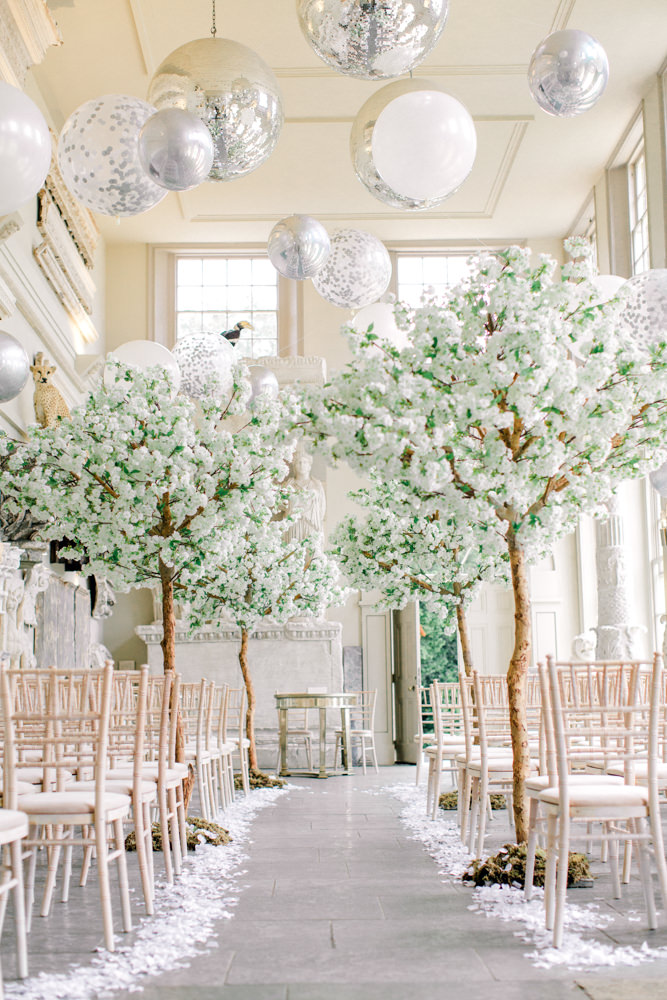 Aynhoe Park orangery ceremony aisle lined with trees