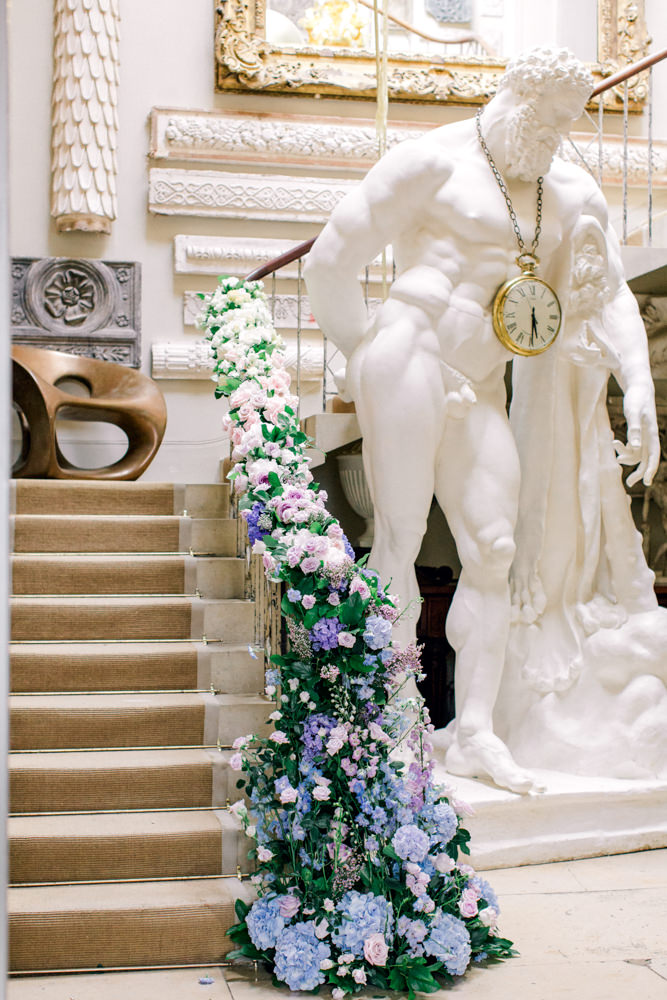 Aynhoe Park staircase with cascading florals