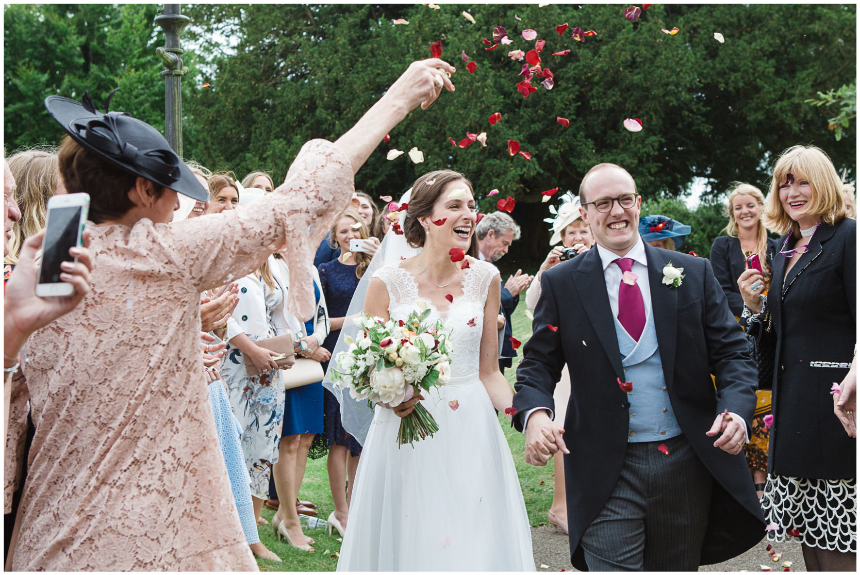Lucy Davenport Photography, Cornwell Manor, wedding venue, Oxfordshire, Cotswold wedding, confetti, bride and groom, church wedding