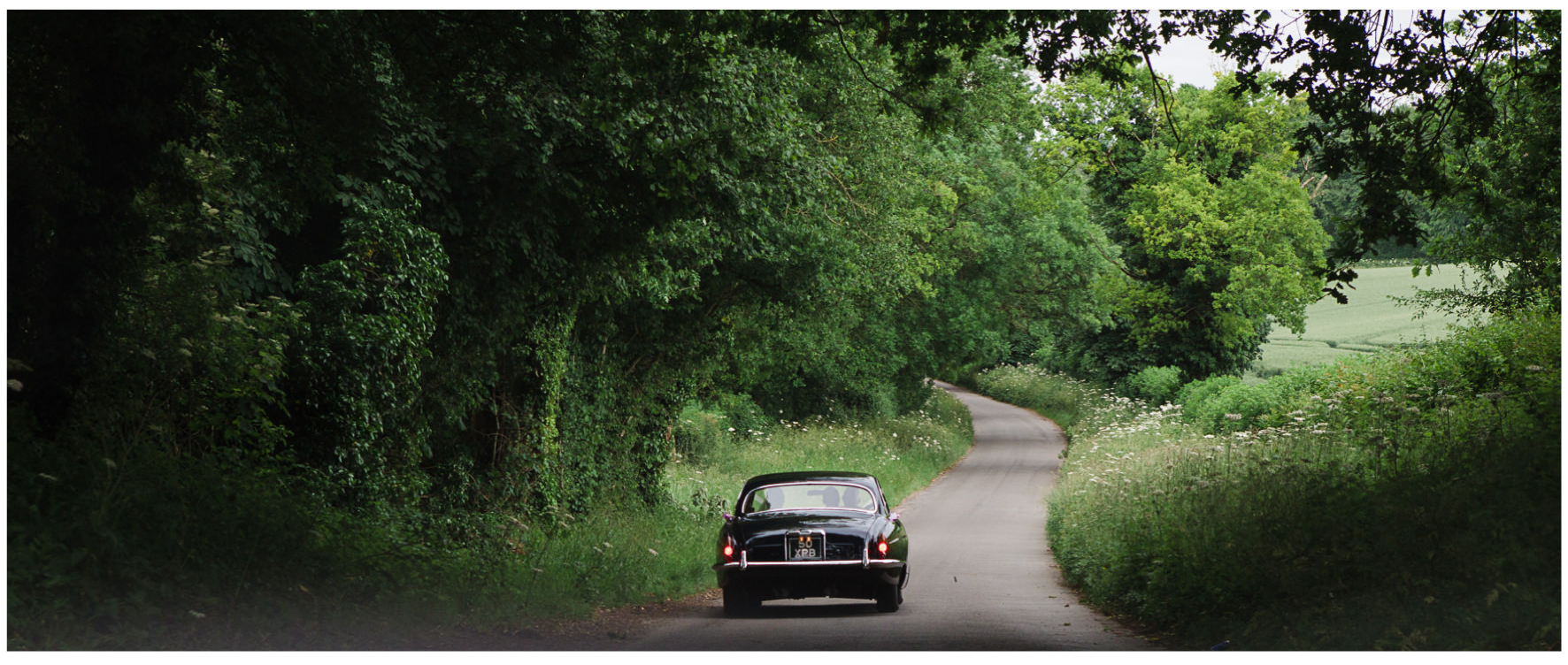 Lucy Davenport Photography, Cornwell Manor, wedding venue, Oxfordshire, Cotswold wedding, wedding car, country lane