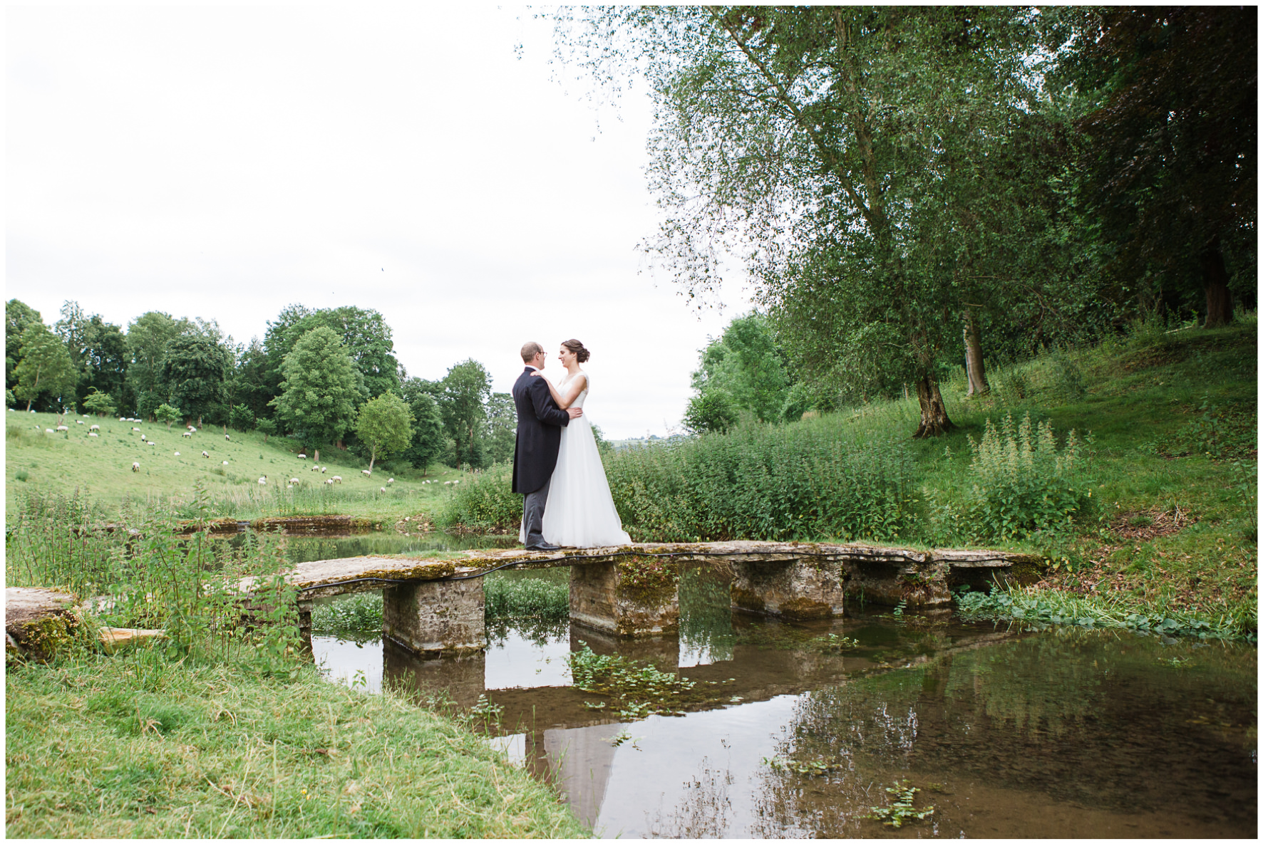 Lucy Davenport Photography, Cornwell Manor, wedding venue, Oxfordshire, Cotswold wedding, bride and groom, bridal couple, couple portraits, stream, bridge, reflection