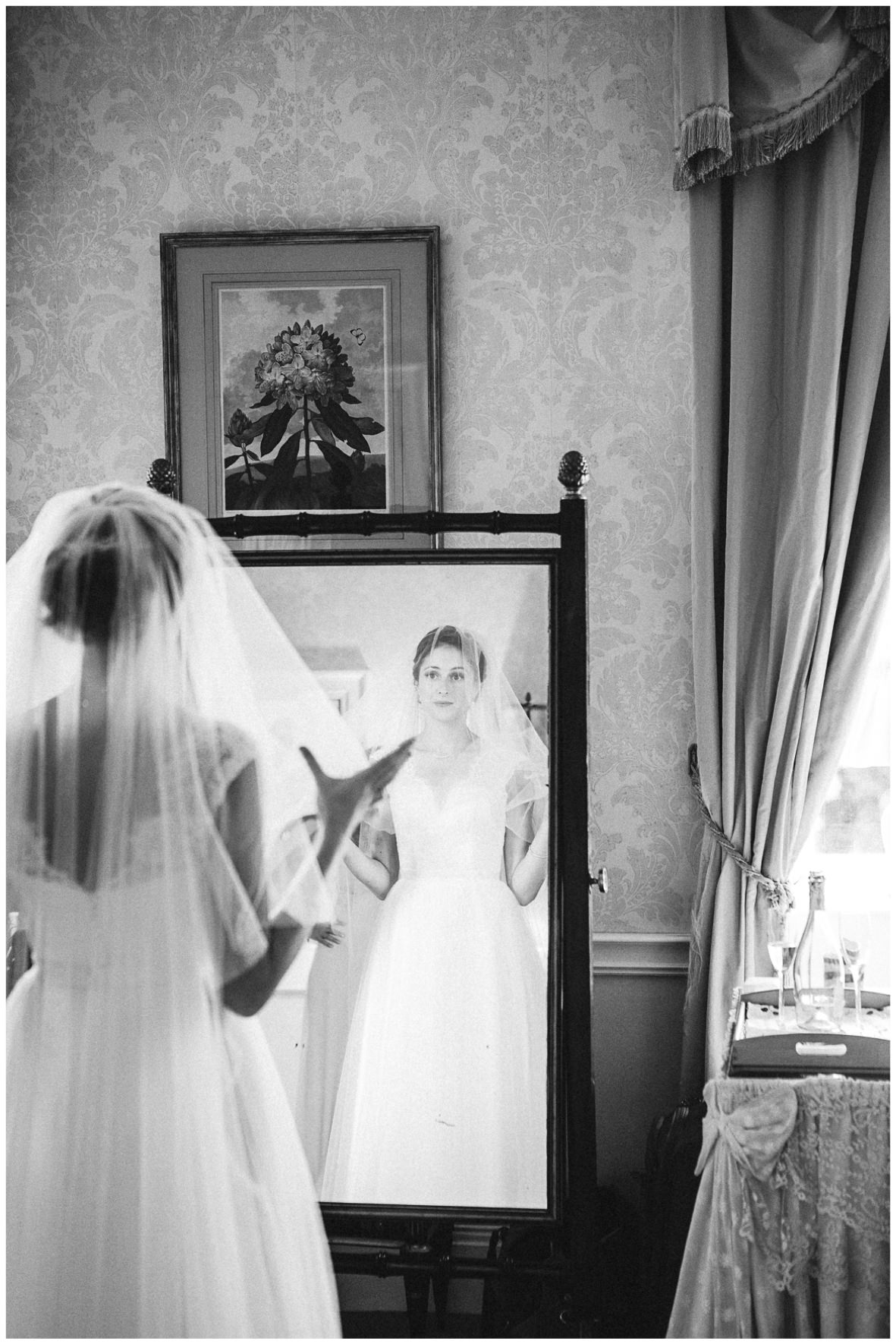 Lucy Davenport Photography, Cornwell Manor, wedding venue, Oxfordshire, Cotswold wedding, bridal suite, bride getting ready, mirror, veil, bride