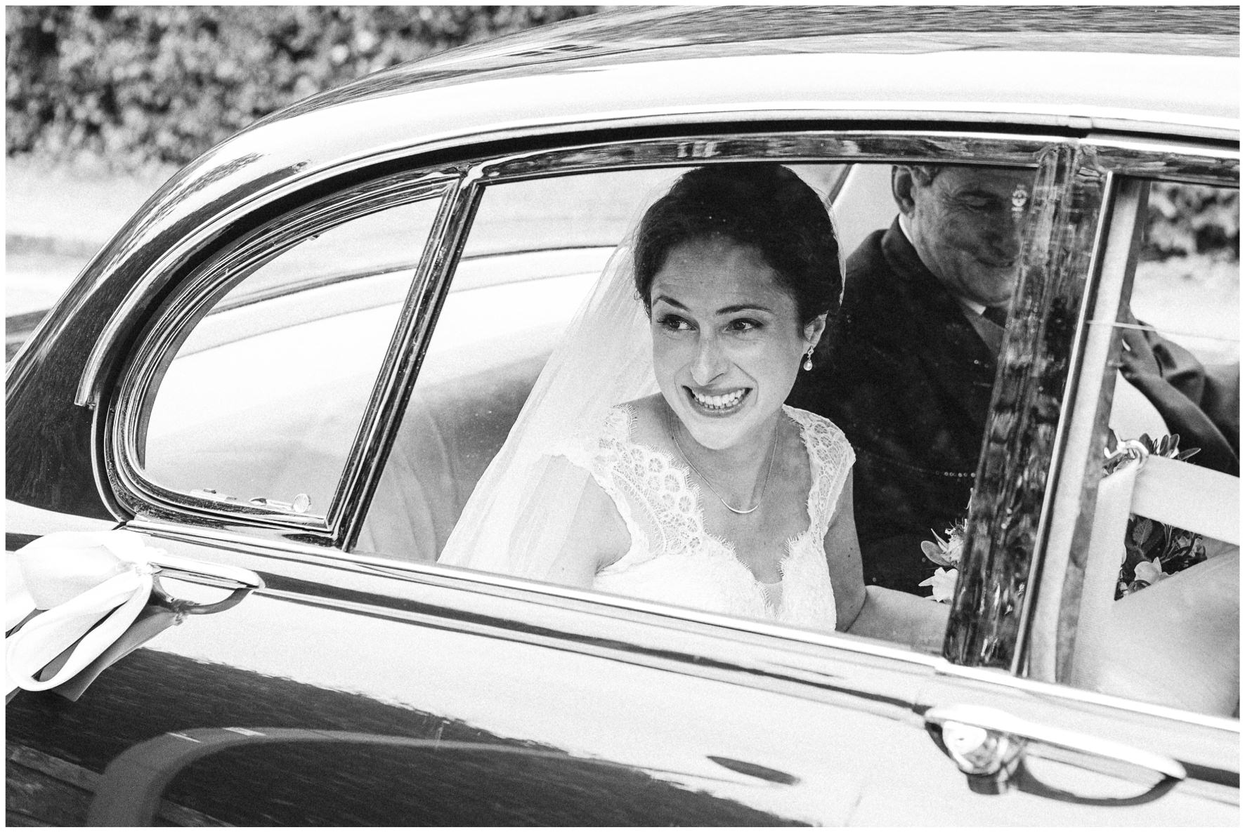 Lucy Davenport Photography, Cornwell Manor, wedding venue, Oxfordshire, Cotswold wedding, Kingham, church wedding, wedding car, bride arriving