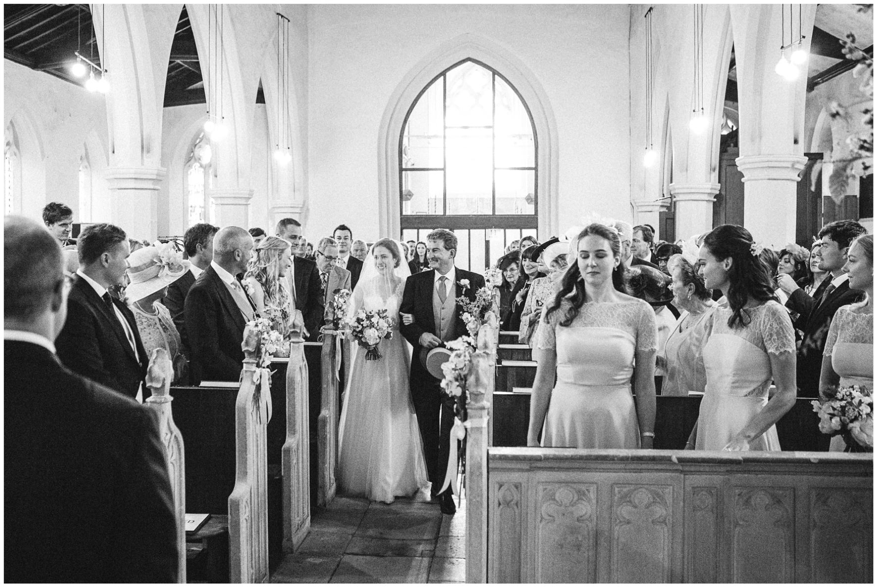 Lucy Davenport Photography, Cornwell Manor, wedding venue, Oxfordshire, Cotswold wedding, Kingham, church wedding, walking down the aisle, bride and father