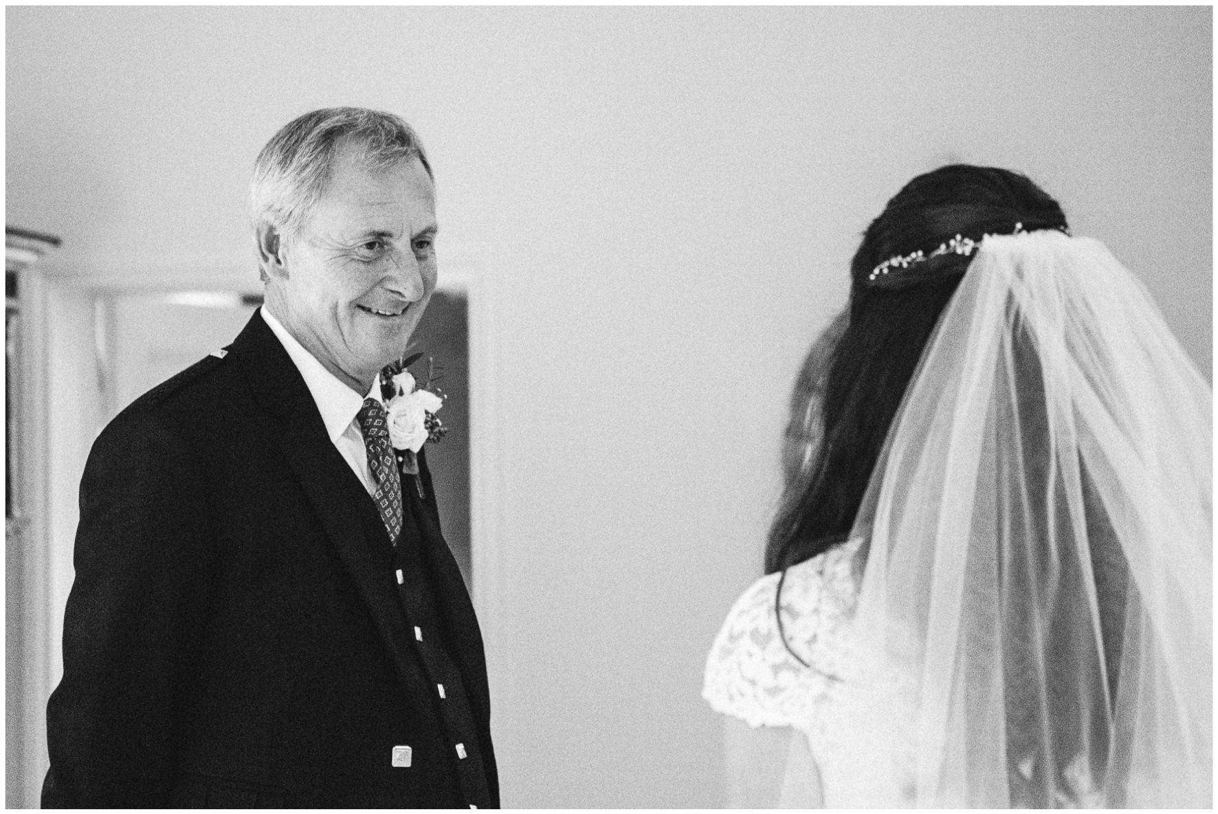 Lucy Davenport Photography, home wedding, marquee wedding, Caroline Castigliano, wedding dress, veil, father of the bride
