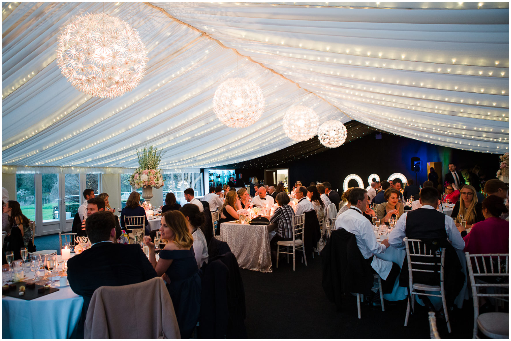 Lucy Davenport Photography, Katrina Otter Weddings, Chippenham Park, guests, marquee