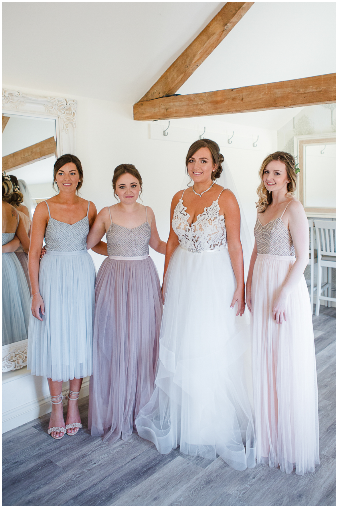 Bride wearing Hayley Paige, bridesmaids Needle & Thread